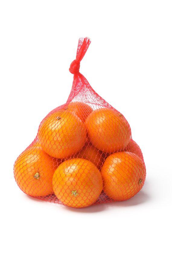 14871324 Fresh Oranges In Plastic Mesh Sack On White Background